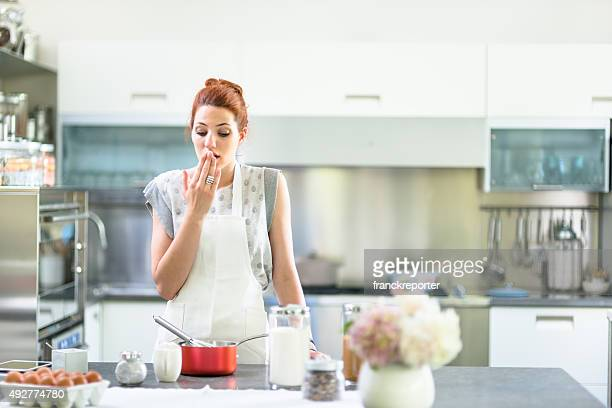 Woman cooking a cake on the kitchen
