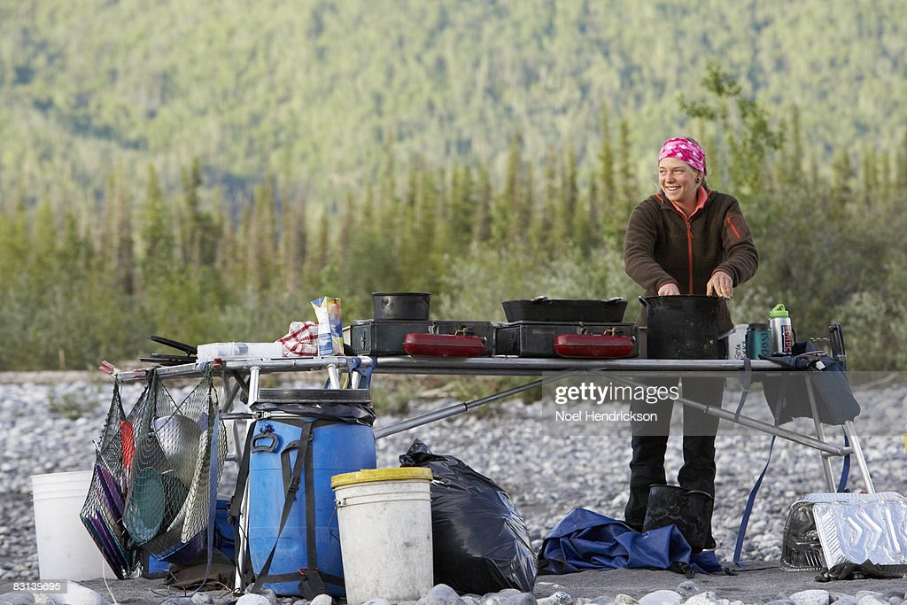 woman cooking at campsite : Stock Photo