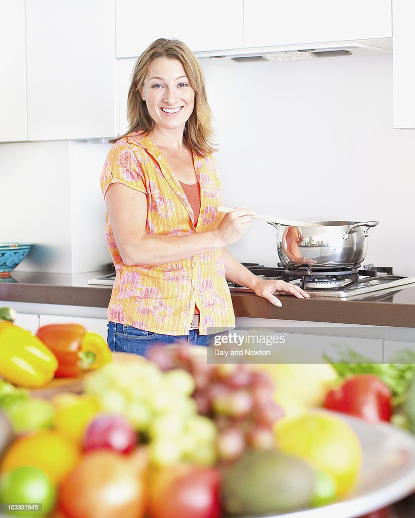 Woman cooking at stove : Stock Photo