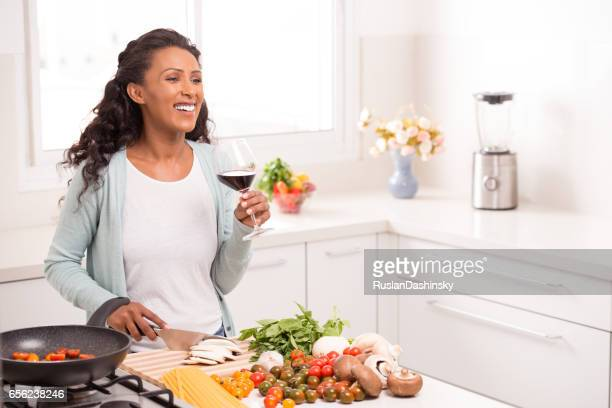Woman cooking dinner.