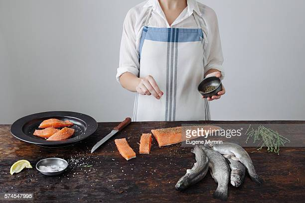Woman cooking fish fillet