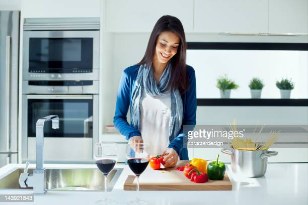 Woman cooking in a modern kitchen.