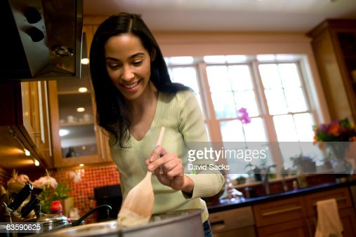 Woman cooking in suburban kitchen : Stock Photo