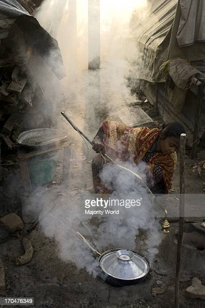 A woman cooking on a mud stove at a shelter by the side of Bolleshwar river in Shoronkhola Khulna Bangladesh January 16 2008 The affected People of...