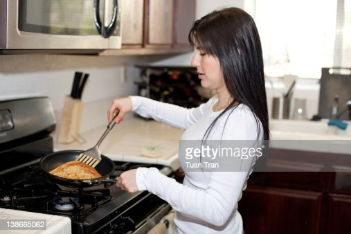 Woman cooking : Stock Photo