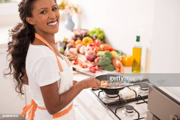 Woman cooking vegetables.