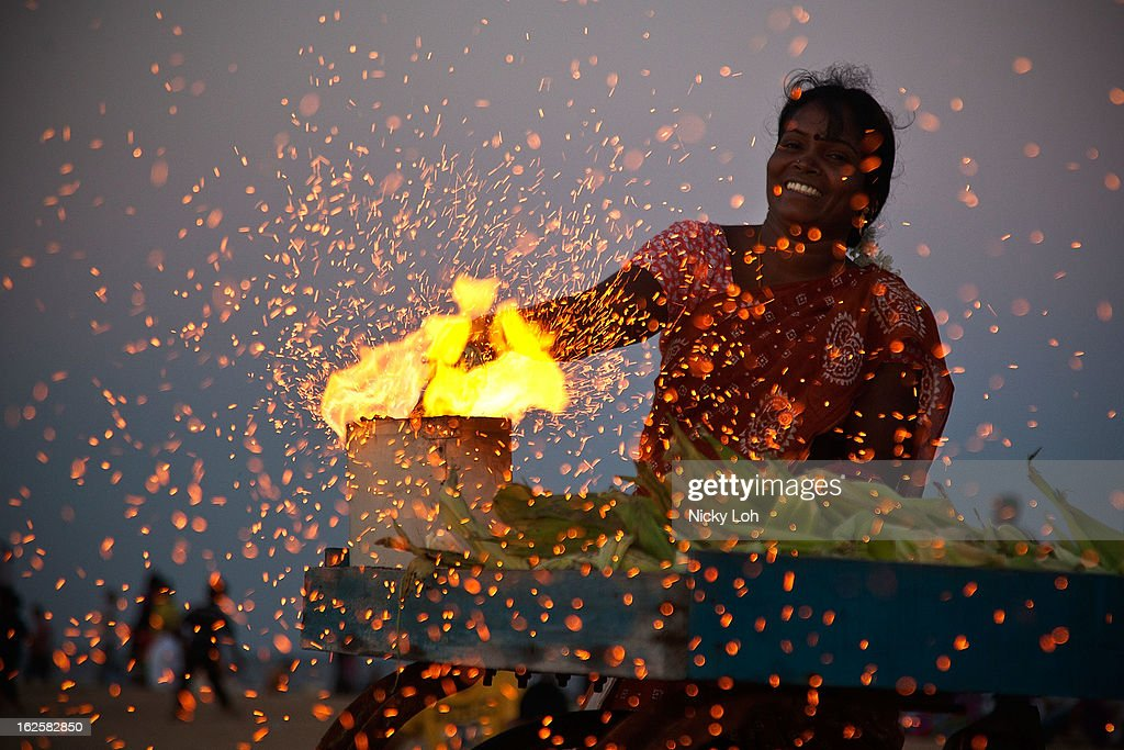 A woman cooks corn at the Marina Beach on February 24, 2013 in Chennai, India. Marina Beach is an urban beach along the Bay of Bengal, which is part of the Indian Ocean. The beach runs a distance of 13km (8.1 miles), making it the longest natural urban beach in the country and the world's second longest.