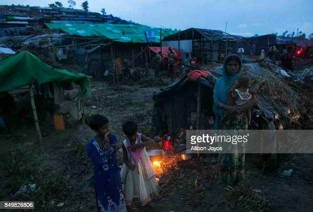 COX'S BAZAR BANGLADESH SEPTEMBER 19 A woman cooks dinner in the Falungkhali Rohingya refugee camp on September 19 2017 in Cox's Bazar Bangladesh Over...