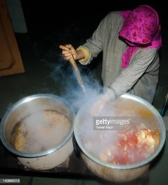 A woman cooks food for Kashmiri Muslim orphan girls in GulshanEBannat Orphanage on March 7 2012 in Gopal Pora 16 Km west of Srinagar the summer...