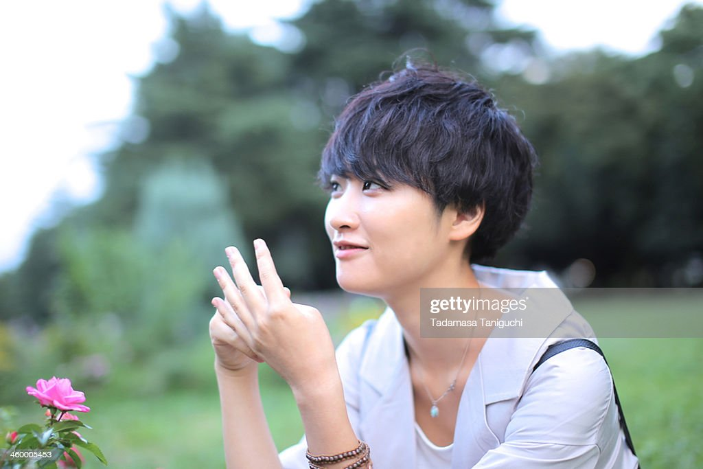 Woman counting happiness : Stock Photo