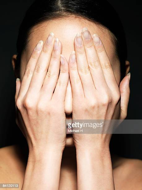 Woman covered her face with hand,portrait,close-up