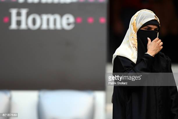 A woman covered in a burqa is pictured prior the Beckenbauer Cup match between FC Bayern Muenchen and Inter Milan at the Allianz Arena on August 5...