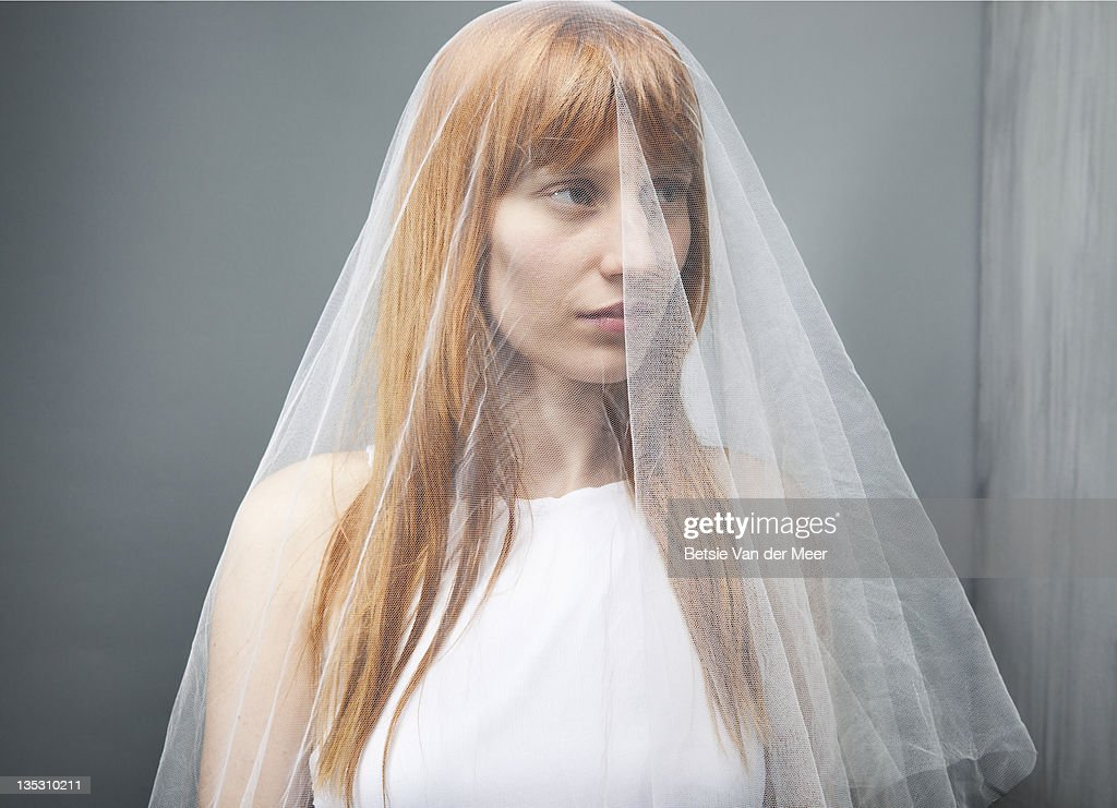 Woman covered in veil. : Stock Photo