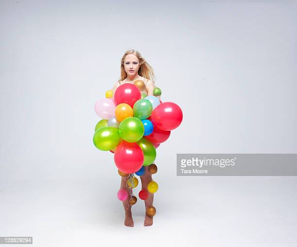 woman covered with balloons