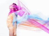 woman covered with bright colorful material