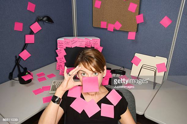 Woman covered with sticky notes