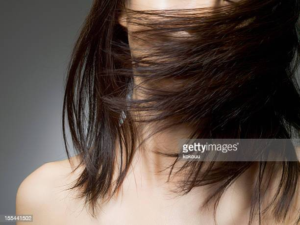 Woman covered with the hair of her