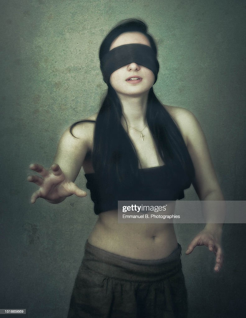 Woman covering eyes : Stock Photo
