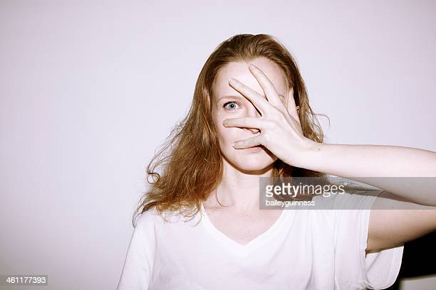 Woman covering her face with hand