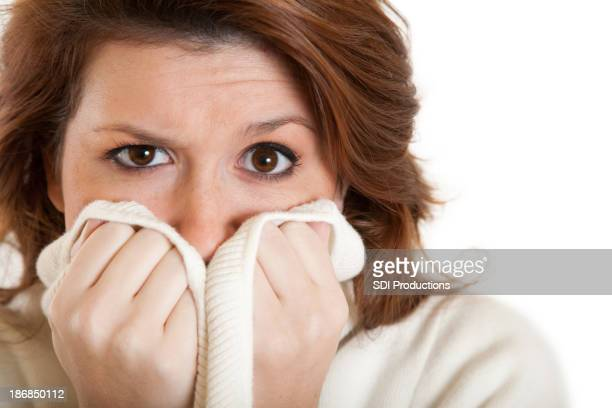 Woman Covering Her Mouth with Sweater