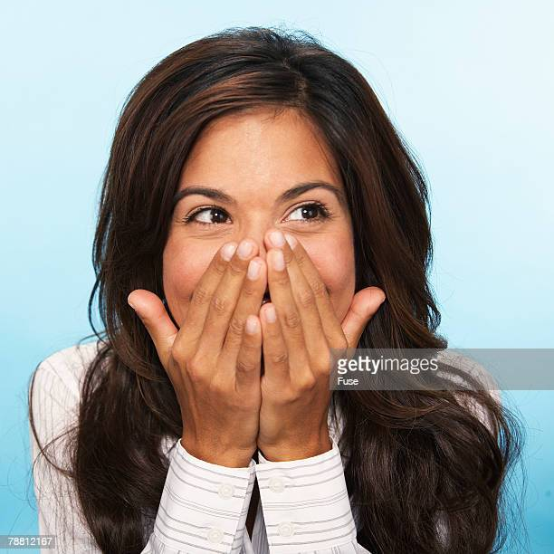 Woman Covering Her Smile with Her Hands