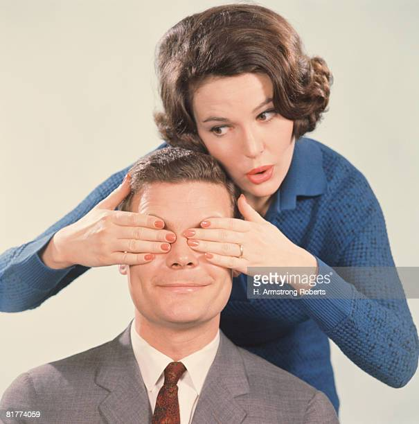 Woman covering man's eyes with hands. (Photo by H. Armstrong Roberts/Retrofile/Getty Images)