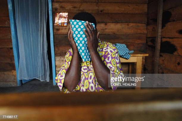 A woman covers her face in a centre for rape victims 25 October 2007 near Goma There are 30000 reported cases of sexual violence per year in the...