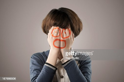 A woman covers the face with both hands