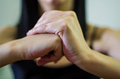 Woman cracking their knuckles, close up