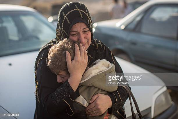A woman cradles her son after being reunited with him after more than two years after fleeing fighting in Mosul on November 7 2016 in Gogjali Iraq...