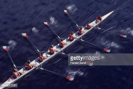 8 woman crew competitive rowing race.