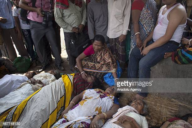 A woman cries after a relative of her died in a stampede during the 'Astami Snan' the Hindu holy bath in the Old Brahmaputra River in Narayanganj...