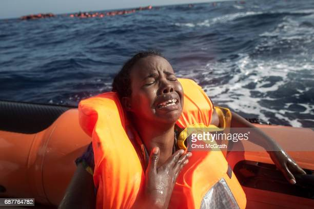 A woman cries after losing her baby in the water as she sits in a rescue boat from the Migrant Offshore Aid Station 'Phoenix' vessel on May 24 2017...