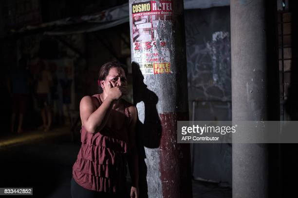 A woman cries after seeing her relative an alleged drug dealer killed during a police antidrug operation in Manila on August 17 2017 Police in the...