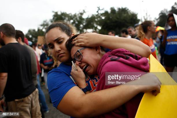 A woman cries and is comforted by a demonstrator after she was refused entry into a planned speech by Richard Spencer a white nationalist who...