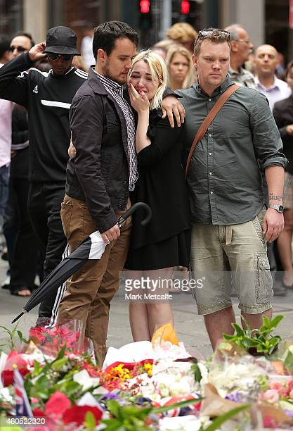 A woman cries as she and friends pay thier respect at Martin Place on December 16 2014 in Sydney Australia Sydney siege gunman Man Haron Monis was...