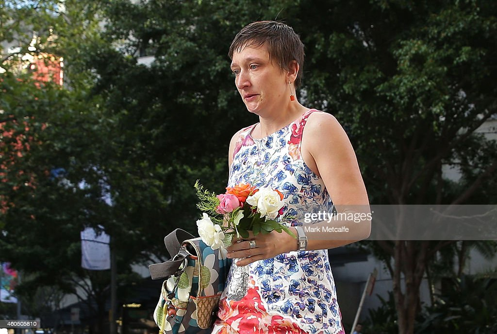 A woman cries as she leaves flowers to pay her respects at Martin Place on December 16 2014 in Sydney Australia The siege in Sydney's Lindt Cafe in...