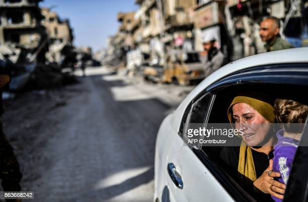 TOPSHOT A woman cries as she looks at her house in Raqa on October 20 after a Kurdishled force expelled the Islamic State group from the northern...