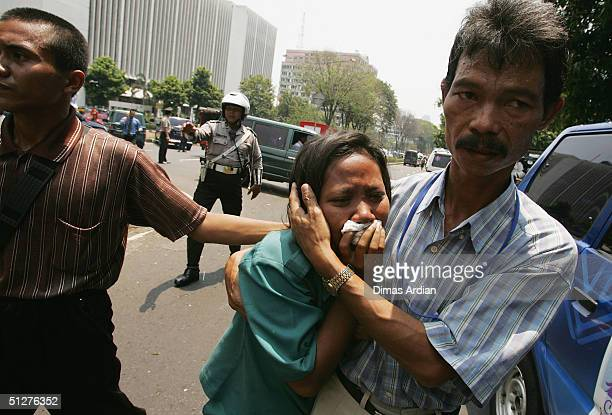A woman cries as she searches for her friend outside the Australian Embassy following a bomb blast Thursday Sept 9 in Jakarta Indonesia A powerful...