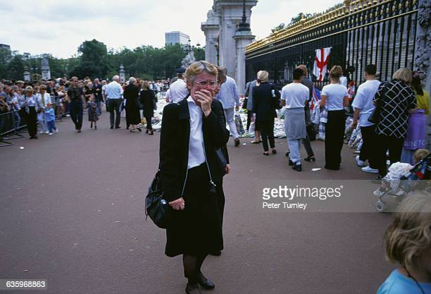 A woman cries as she stands at the gates of Buckingham Palace after the tragic automobile accident in Paris on August 31 in which Diana Princess of...