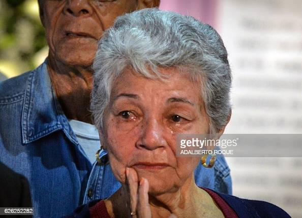 A woman cries as she waits to pay the last respects to Cuban revolutionary icon Fidel Castro at Jose Marti's Memorial at Revolution Square in Havana...