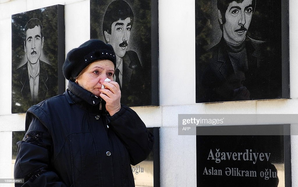 A woman cries as she walks at Alley of Martyrs, a cemetery and memorial dedicated to those killed by Soviet troops during the 1990 Black January crackdown, in Baku, the capital of Azerbaijan, on January 17, 2013. Azerbaijan marks the 23rd anniversary of the Black January crackdown of the Azerbaijani independence movement in Baku by the Soviet Army in 1990. AFP PHOTO/ TOFIK BABAYEV