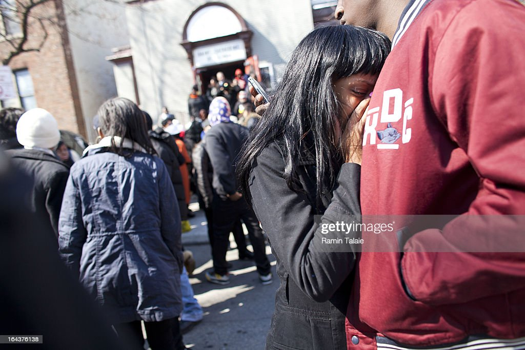 A woman cries as the casket of Kimani Gray, 16, is carried out after a funeral service on March 23, 2013 in the Brooklyn borough of New York City. Kimani Gray was shot and killed by New York police officers for allegedly pointing a gun at them.