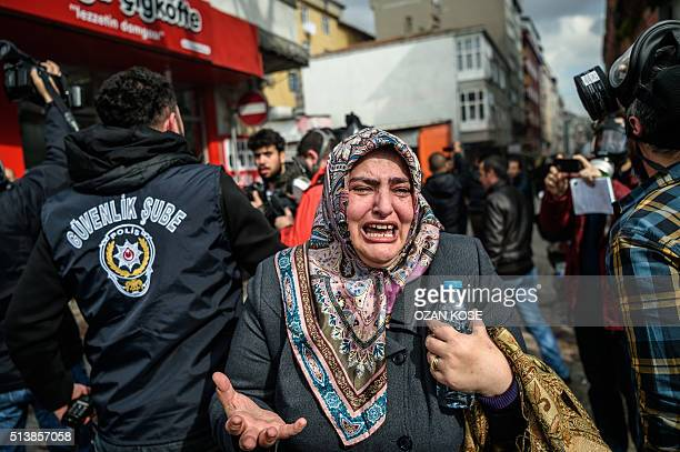 A woman cries as Turkish antiriot police officers disperse supporters in front of the headquarters of the Turkish daily newspaper Zaman in Istanbul...