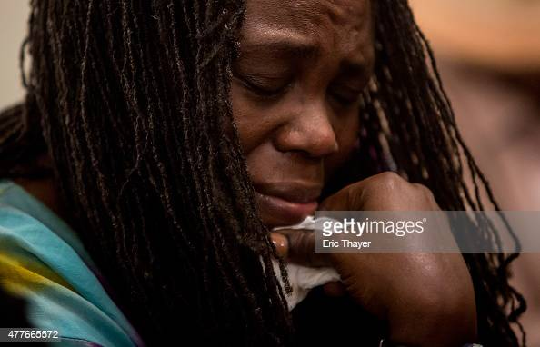 A woman cries at a prayer vigil for the nine victims of last night's shooting at the historic Emanuel African Methodist Episcopal Church in...
