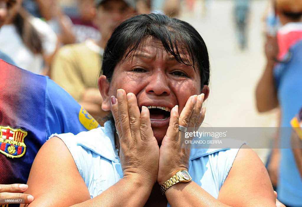 A woman cries at the crime scene in which five people -- including a high school student -- were shot dead in the suburb of La Haya, in northern Tegucigalpa, on April 15, 2013. In March 2012, the UN announced Honduras had the world's highest murder rate, at 82.1 deaths per 100,000 people, while a local observatory on violence put the rate at 86.5 per 100,000. AFP PHOTO/Orlando SIERRA