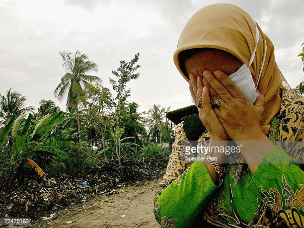 A woman cries beside a mass grave of tsunami victims January 2 2005 in Banda Aceh Indonesia The province of Banda Aceh one of the worst hit regions...