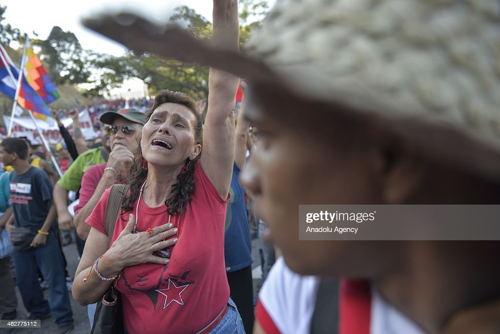 A woman cries during a military parade for the 23rd anniversary of attempted coup of Hugo Chavez against Carlos Andres Perez government on 1992 in...