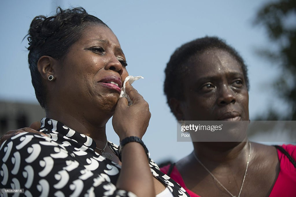 A woman cries during a remembrance ceremony during a ceremony in observance of the terrorist attacks of 9/11 at the Pentagon September 11, 2013 in Arlington, Virginia. Family members of the Pentagon attack victims and survivors of the attack gathered to hear from Obama and other leaders at the National 9/11 Pentagon Memorial near the place where terrorists drove a jetliner into the Department of Defense headquarters in 2001.