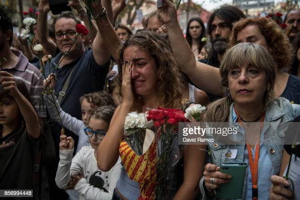 A woman cries during a tribute outside a school which acted as polling station in the referendum and was subsequently raided during a regional...